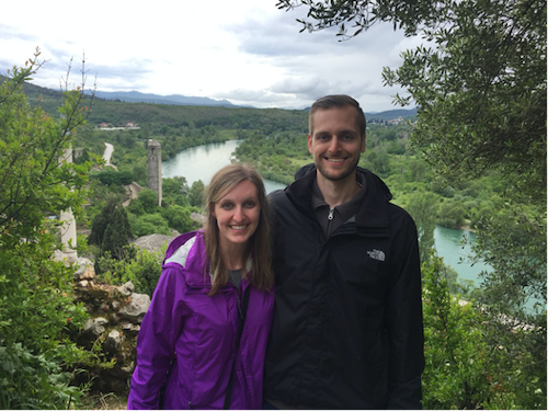 Dr. Keenan Fischman and his wife standing outside near a river